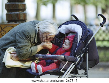 The grandmother feeds with milk of the grandson - stock photo