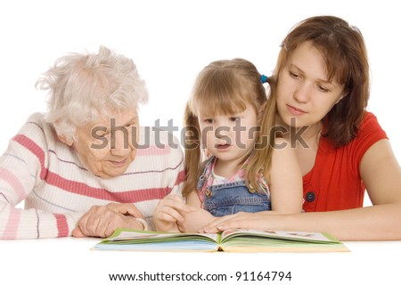 The grandmother with the grand daughter read - stock photo