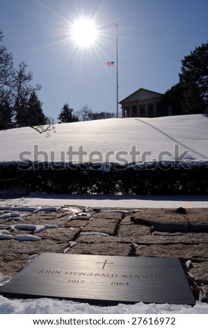 The grave of President John F. Kennedy, eternal flame and the Arlington House at the Arlington National Cemetery in Virginia. - stock photo
