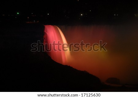 The Great Niagara Falls at night, lit up by colored lights in Canada 3 - stock photo
