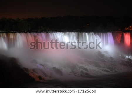 The Great Niagara Falls at night, lit up by colored lights in Canada 12 - stock photo