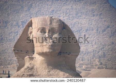 The Great Sphinx of Egypt with Pyramids of Khufu - stock photo