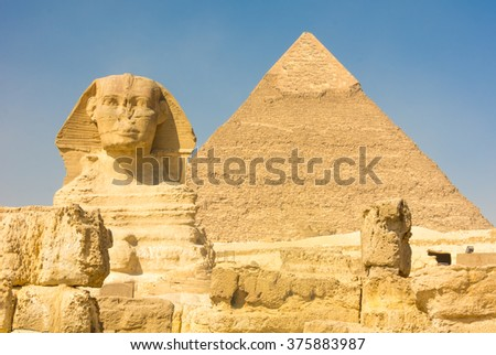 The Great Sphinx of Giza with the great pyramid of Kufu in the background. Giza, Egypt - stock photo