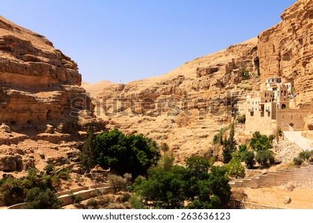 The Greek Orthodox Monastery of Saint George in Wadi Qelt, Judean Desert, panoramic - stock photo