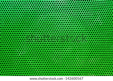 the green grate background with holes - stock photo