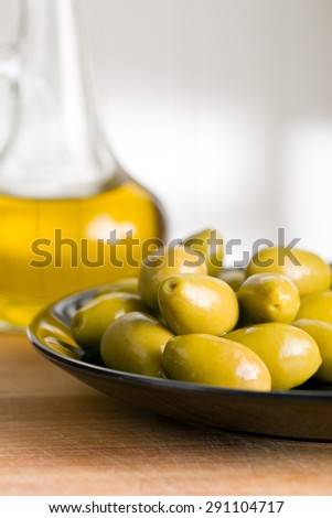 the green olives and olive oil - stock photo