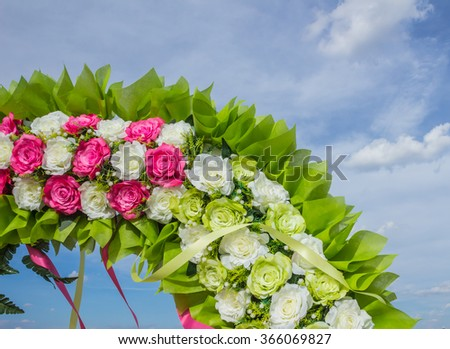 The green plastic flowers. - stock photo