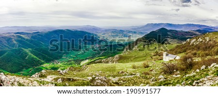 The green Vipava Valley from the Nanos plateau. Church of St.Jerome in the right corner.  - stock photo
