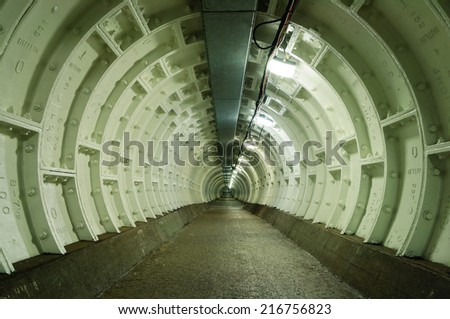 The Greenwich Foot Tunnel crosses beneath the River Thames, linking Greenwich in the south with the Isle of Dogs to the north - stock photo