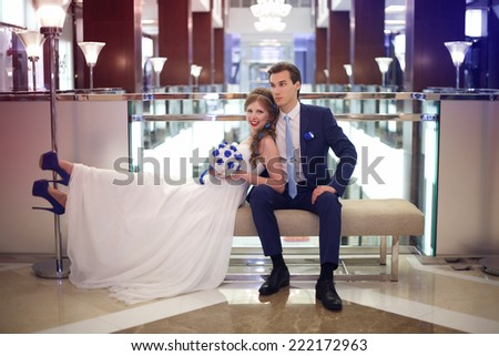 The groom and the bride in a beautiful interior. Wedding day - stock photo
