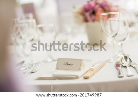 The Groom's and the Bride's places at the wedding table with a low depth of field - stock photo