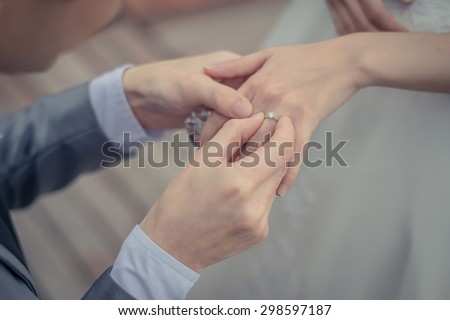 The groom wore a bride's wedding ring - stock photo