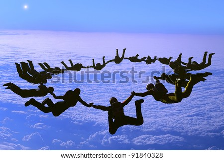 The group of athletes in the sky. - stock photo