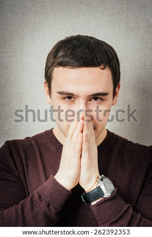 the guy blows his nose and sneezing - stock photo
