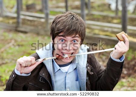 The guy eats kebab - stock photo