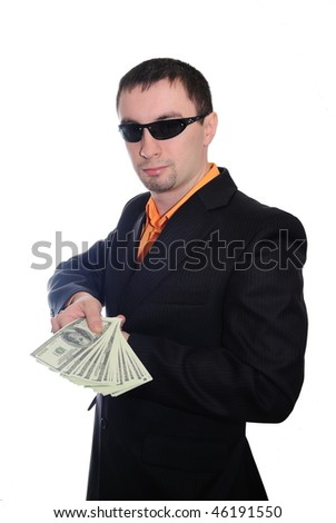 The guy in dark glasses transfers money. Isolate on white - stock photo