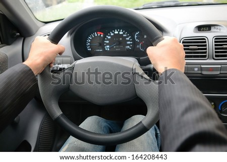 The guy in the suit is driving - stock photo