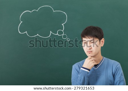 The guy pensive mood, speculates cloud drawn on the chalkboard - stock photo