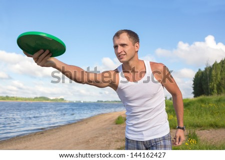 The guy throws a plate - stock photo