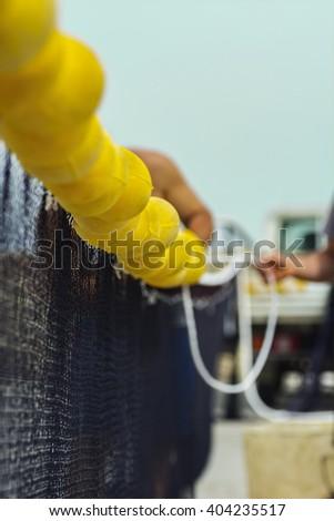 The guy who makes fishing net - stock photo