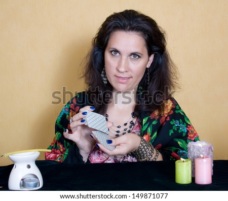 The gypsy tells fortunes by cards - stock photo
