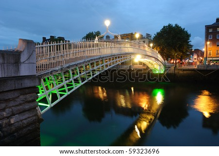 The Ha'Penny Bridge over the River Liffey in Dublin, Ireland. - stock photo