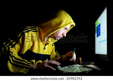 The hacker hacks a credit card through the internet - stock photo