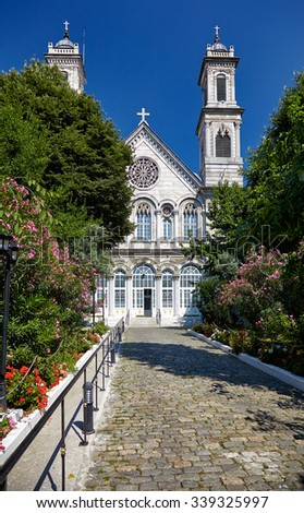 The Hagia Triada Church is built in neo-baroque style with the twin bell towers a large dome and a neo-gothic facade. The church is located near Taksim Square. Istanbul, Turkey - stock photo