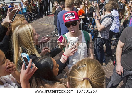 THE HAGUE, HOLLAND - MAY 3: Niall Horan of the boy band One Direction leaves Hotel des Indes in The Hague, Holland on May 3, 2013 - stock photo