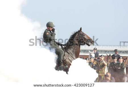 The Hague, Holland - September 15 2014: The honorary escort exercise their horses on the beach for opening of the parliamentary year a day later in the Hague in The Netherlands - stock photo
