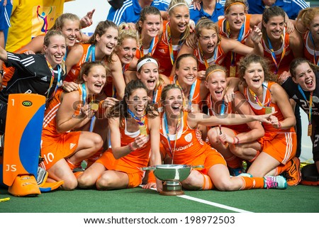 THE HAGUE, NETHERLANDS - JUNE 14: the Dutch women field hockey team poses for a team photo after winning the world championships hockey at the Rabobank Hockey world cup 2014 - stock photo
