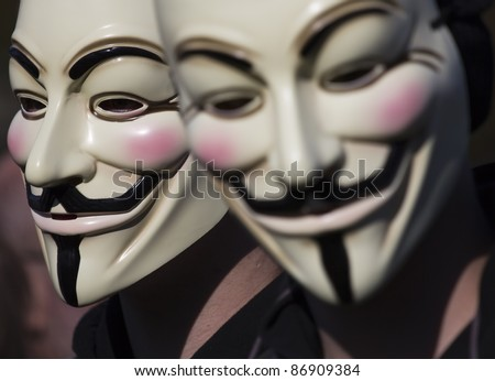 THE HAGUE – OCTOBER 15: Two masked members of Anonymous demonstrating during the Occupy protest on October 15, 2011 in The Hague, The Netherlands. - stock photo