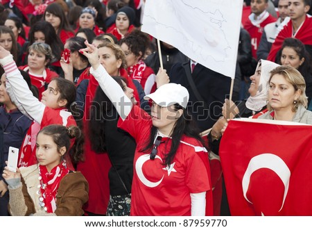THE HAGUE - OCTOBER 30: Unidentified Turkish men and women protest against the Kurdistan Workers Party (PKK) on October 30, 2011 in The Hague, The Netherlands. - stock photo