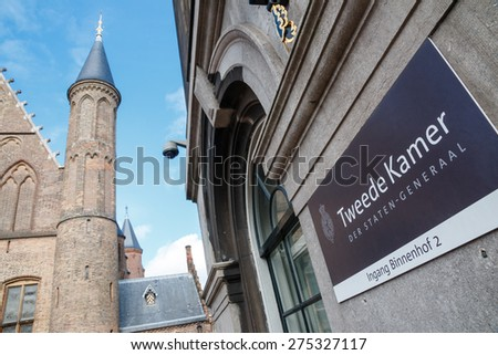 THE HAGUE, THE NETHERLANDS - APRIL 25 2015: Entrance of Dutch House of Representatives from the Binnenhof side. In the background one of the towers of the Hall of Knights - stock photo