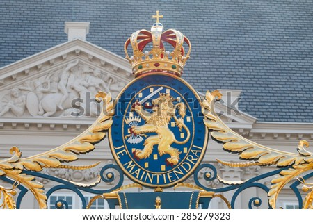 THE HAGUE, THE NETHERLANDS - APRIL 25 2015: Royal coat of arms of the Kingdom of the Netherlands on the gate of the Noordeinde Palace in the Hague - stock photo
