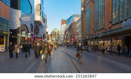THE HAGUE, THE NETHERLANDS - 8th of February 8th, 2015: Tourists and locals walk on the Grote Marktstraat shopping street, close to Spui. - stock photo