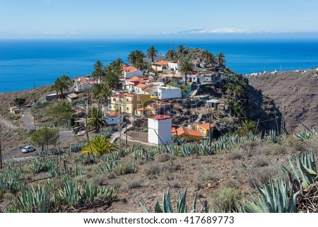 The hamlet Arguayoda in the southwest of the island Gomera. The settlement, located at the hillside of a rock is close the village La Dama known from agriculture and the canyon Barranco de la Rajita - stock photo