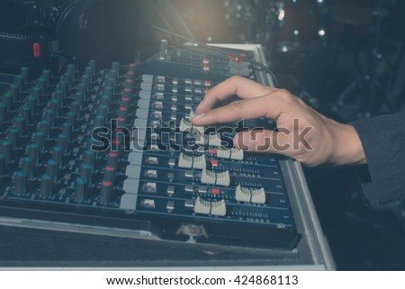 The hand adjust sound audio mixer board,retro tone - stock photo