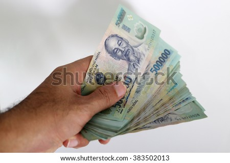 The Hand get Money Singapore dollar with white Background - Way to succesfull, Earn Money - stock photo