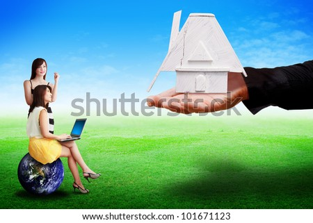 The hand give the House to lady : Elements of this image furnished by NASA - stock photo