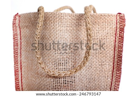 The Hand is a part of the eco Shopping bag made out of recycled Hessian sack - stock photo
