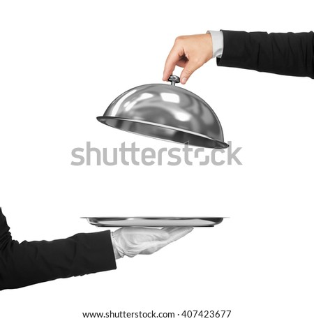 The hand of the waiter holding cloche over empty tray on an isolated white background. Concept of First Class Service on white background - stock photo