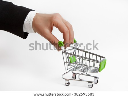 The hand with the empty grocery cart - stock photo