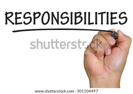 The hand writing responsibilities - stock photo