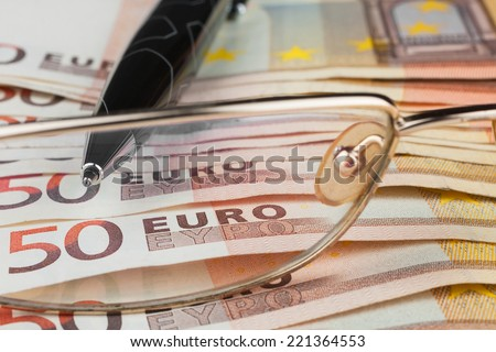 The handle and glasses  is on the euro, can be used as background - stock photo