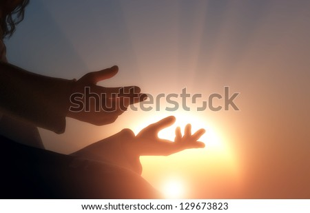 The hands of the religious man. - stock photo