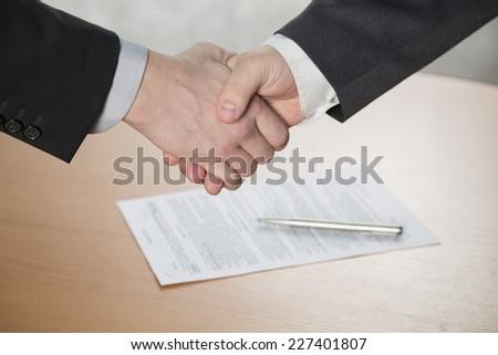 the handshake,the two men shake hands - stock photo