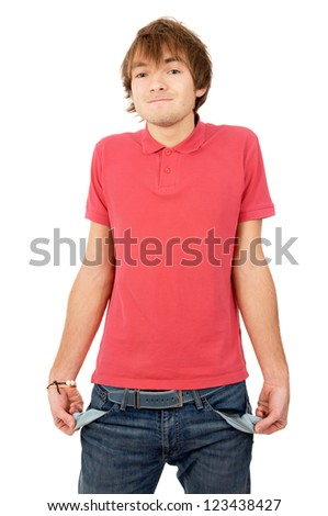 the handsome young man turned his pockets out and shows that he has nothing isolated on white background - stock photo