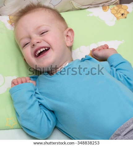 The happy baby face causes affection and positive emotions, illustrating pleasure from life and a present situation - stock photo