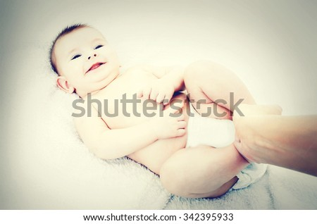 The happy baby lying on a blanket - stock photo